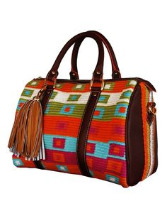 Artisan crafted handbag, woven colorful Wayuu print, tassel detail and adjustable shoulder strap