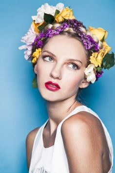 not only do i love the flowers-in-hair trend, but that berry pout is on point! #r29summerstyle