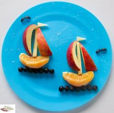 Sailboats make from apples and orange