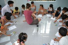 Rock-Paper-Scissors Volunteer Artist, Marina Cariello working with the kids, summer 2014.