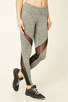 A pair of heathered knit leggings with mesh panels, an elasticized waist, moisture management, and a hidden key pocket.