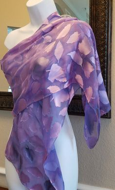 Pure silk Hand painted Silk scarf. Floral Lilac silk Scarf. Made to Order scarf. Perfect to wear or unique gift. Hand rolled hem silk scarf. This Luxurios silk shawl is hand painted in beautiful blend of Lilac, purple and black colors. The rich colors blend with the fabric, giving the silk soft and luxurious look and feel. The dyes are non-toxic and have been steam set for permanence. Scarf is Washable. This shawl size is 14x72. Other choice of Sizes by Request: 8x 54 or 14x60 or 22 x 72...