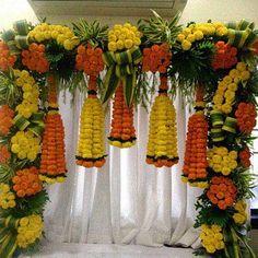 Orange and Yellow Floral Bottle Shape Decoration Desi Wedding Decor, Wedding Stage Decorations, Diwali Decorations, Floral Decorations, Marriage Decoration, Flower Decoration For Ganpati, Ganesh Chaturthi Decoration, Janmashtami Decoration, Flower Garland Wedding