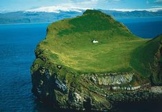 """Enchanting house located on an island called Elliðaey near Vestmannaeyjar, a small archipelago off the south coast of Iceland. The house was given to singer, Bjork from her motherland as a """"Thank You"""" for putting Iceland on the international map. Beautiful Places To Live, Oh The Places You'll Go, Places To Visit, Amazing Places, Peaceful Places, What A Wonderful World, Beautiful World, Beautiful Scenery, Places"""