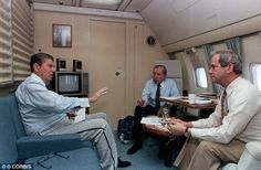 ROBERT MCFARLANE (right) was the National Security Adviser to President Ronald Reagan (left), seen together on Air Force One in May 1988. ~ (Check out President Reagan's sweatpants!)