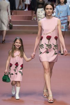 Mom and daughter in matching Dolce & Gabbana fall 2015 rose dresses