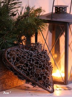Heart made of chicken wire fencing and filled with pinecones or other natural material.