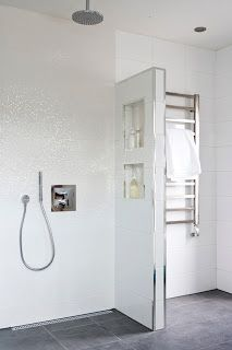 These sparkling touches in the a white bathroom give it a luxury designer feel Grey Bathroom Floor, Modern White Bathroom, Bathroom Inspo, Bathroom Inspiration, Bathroom Wall, Small Bathroom, Bathroom Ideas, Bathroom Toilets, Amazing Bathrooms