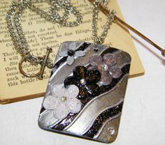 Silver and Black Rectangular Floral Artwork Shell by ArtLery, $22.00