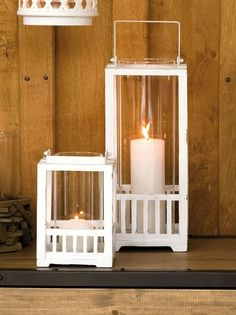 white distressed wooden hurricane lamps