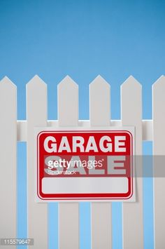 Stock Photo : Garage Sale Sign On White Picket Fence