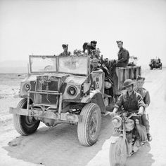 Members of the British Royal Horse Artillery First Armoured Division pose with their Canadian Chevrolet-built CMP truck messenger motorcycle and canine mascot Tunisia 22 April Royal Horse Artillery, Afrika Corps, North African Campaign, British Armed Forces, War Dogs, Army Vehicles, Ww2 Tanks, Military History, World War Two