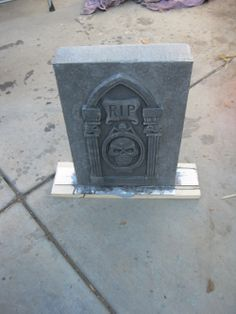glue dollar store foam tombstone to cardboard box to enlarge. add to base for weight.