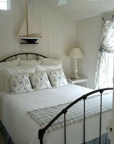 white bedroom with black metal bed
