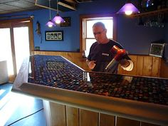 We're finally closer to finishing the bar top we started over a year ago. Luke had been collecting bottle caps for years with no real plan of what to do with them. We had millions (it seemed)…