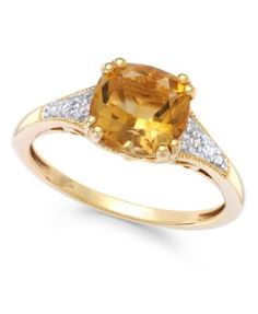 Citrine (2-1/5 ct. t.w.) and Diamond Accent Ring in 14k Gold $420.00 Add a glowing touch with this bold, diamond-accented ring. Set in 14k gold, cushion-cut citrine (2-1/5 ct. t.w.) ensures a look that's full of sunshine.