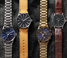 Family portrait. From left to right: the Sentry SS, the Sentry Leather, the Sentry Chrono, the Sentry 38 Leather - blue face - black face - leather band - stainless steel band & case - Silver - Gold - Saddle - Brown Gator