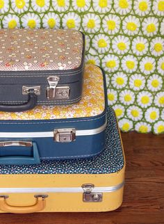 Add a vibrant layer of floral fabric to a vintage suitcase to make creative storage.