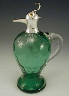 Green glass and silver plate Art Nouveau decanter in the form of a bird. Glass is possibly by Moser  Possibly Austrian  c.1910