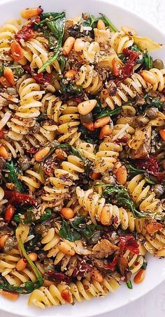 Italian Pasta with Spinach Artichokes. Italian Pasta with Spinach Artichokes Sun-Dried Tomatoes Capers Garlic and Pine Nuts! This meatless vegetarian pasta dish has only 8 ingredients and takes 30 minutes to make! Veggie Recipes, Salad Recipes, Vegetarian Recipes, Dinner Recipes, Healthy Recipes, Meatless Pasta Recipes, Italian Pasta Recipes, Fusilli Recipes, Light Pasta Recipes
