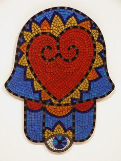 Heart Hamsa | Katrina Doran Size: 24 x 19 inches Materials: silver backed glass and vitreous glass