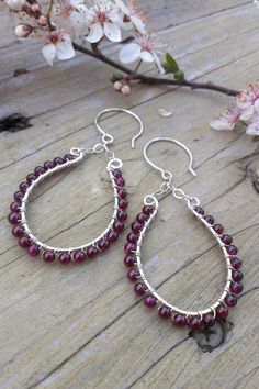 Gorgeous Garnets Wrapped in Sterling on Oval Frame by gotsparkles