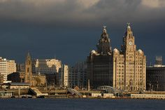 Royal Liver Building on the Mersey Waterfront..great contast with grey cloud background with the last glint of the sunset