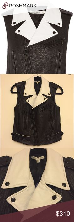 SUNDAY SALE🎉NWT Rebecca Minkoff Lambskin vest NWT!! So sleek! This Lambskin leather vest fits like a glove and makes a statement!! Fabulous details: White contrast collar with bottondown snaps, white contrast on back of arms and black zippers.  A wardrobe staple! Rebecca Minkoff Jackets & Coats Vests