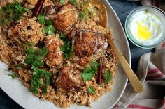 """A stunningly fragrant one-pot meal, this chicken and rice dish came to The Times from Yotam Ottolenghi and Sami Tamimi's smash hit """"Jerusalem: A Cookbook."""" Spiced with cinnamon, cardamom and whole cloves, its aromatic earthiness is balanced by plenty of herbs — dill, parsley and cilantro — for freshness and tang And caramelized onions and dried barberries (or currants) contribute a gentle sweetness This is dinner party food that is at once elegant and supremely comforting."""