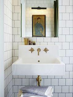 brass fixtures and subway tiles. #bathroom #interiors #decor