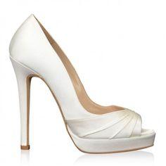 http://www.bellissimabridalshoes.com/trends/platform-wedding-shoes/Niki-By-Oscar-de-la-Renta-In-White  Niki By Oscar de la Renta In White