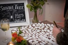 Signing tree (wedding guestbook) with chalkboard sign