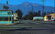 Cucamonga,1950's.  Looking north on Archibald Ave from Foothill Blvd (Route 66). FRANK ZAPPA  had his recording studio in the gray building on the left side behind the turquoise building in the 60's.