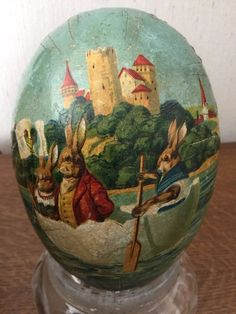 Charming chromolithograph on an egg container. Possibly a view from the Rhine river due to the view of the castle-like buildings in the background.T