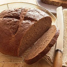 Pumpernickel Rye Recipe Breads with active dry yeast, full-flavored molasses, butter, cider vinegar, unsweetened chocolate, whole wheat flour, rye flour, unsweetened cocoa powder, caraway seeds, salt, instant espresso powder, bread flour, vegetable oil, cornmeal, eggs