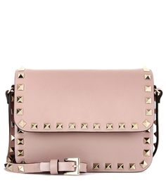 Valentino - Rockstud leather shoulder bag - Downsize your tote to this practical shoulder bag from Valentino. Classic taupe leather finished with the label's iconic Rockstud hardware makes for a modern and edgy fusion. Wear it over the shoulder or across your body, next to bright colours and monochrome ensembles alike. - @ www.mytheresa.com