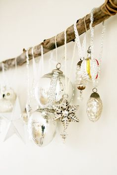 I like this idea - group a collection of special ornaments and hang them from a branch instead of on the tree. Could also do this with stockings since we have no fireplace.