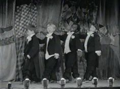 """1941 - 'MELODIES OLD AND NEW' Mickey, Froggy, Buckwheat, and Spanky singing """"While Strolling Through the Park One Day."""""""