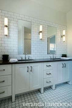 black countertops with white cabinets and white subway tile.