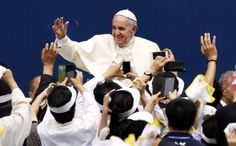 Pope Francis is greeted by followers as he arrives to attend a mass at Daejeon World Cup Stadium on August 15. Photo: AFP