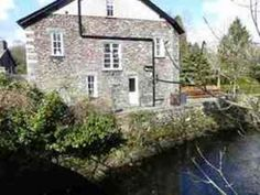 Tradional Lakeland Cottage next to River Rothay Quiet Corner near Village Centre. Holiday cottage for rent from with the added security of our fraud protection. Lakeland Cottage, Open Field, Cumbria, Lake District, Fields, Swimming Pools, Patio, River, House Styles