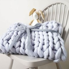 Softly textured, oversized, and inviting - a chunky knit blanket is the home update we never knew we needed.