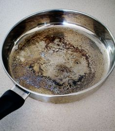 CLEANING A BURNT PAN:  1. Fill the bottom of the pan with a layer of water (about a cup).    2. Add one cup vinegar.    3. Bring the pan to a boil. It should be looking a bit cleaner already.    4. Remove the pan from the heat and add two TBSP baking soda. Expect fizz!    5. Empty the pan and scour as normal, if necessary add an extra bit of dry baking soda.    6. If there are any super stubborn marks that don't come off with scouring, make a paste of baking soda and a couple of drops of…