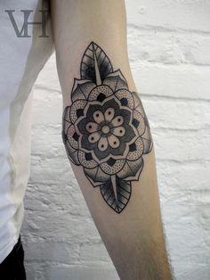 mandala elbow tattoo