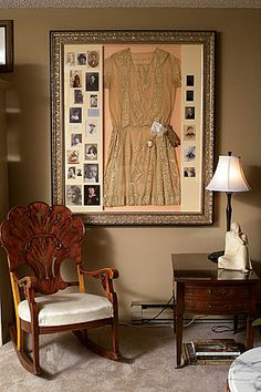 Isn't that display beautiful with the ancestor photos & the vintage dress? Love it! What a sentimental thing to do with your mom's or grandma's dress!