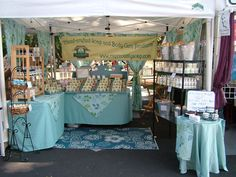 Farmers Market Booth Ideas - Bing Images. Love the shelving unit and small round table at the front.