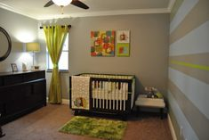 This #modern #nursery uses small pops of #green for big effect.
