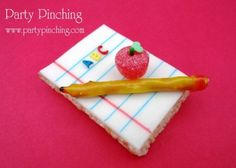 Here's a cute little Back-to-School snack!  A Rice Krispie Treat topped with white fondant.  I used edible markers to make it look like paper and added alphabet sprinkles.  The apple is a gumdrop with a green jimmie and heart sprinkle and the pencil is a pretzel stick wrapped in a yellow fruit roll up.  Just dip the end of the pencil in a little melted chocolate for the tip and roll a bit of red fruit roll up for the eraser.