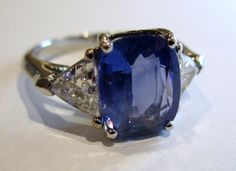 Menashe & Sons Jewelers Custom Cushion cut blue sapphire with trillian cut diamond ring