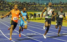 Yohan Blake (left) powers to the finish ahead of world-record holder Usain Bolt (second from right) (AP)
